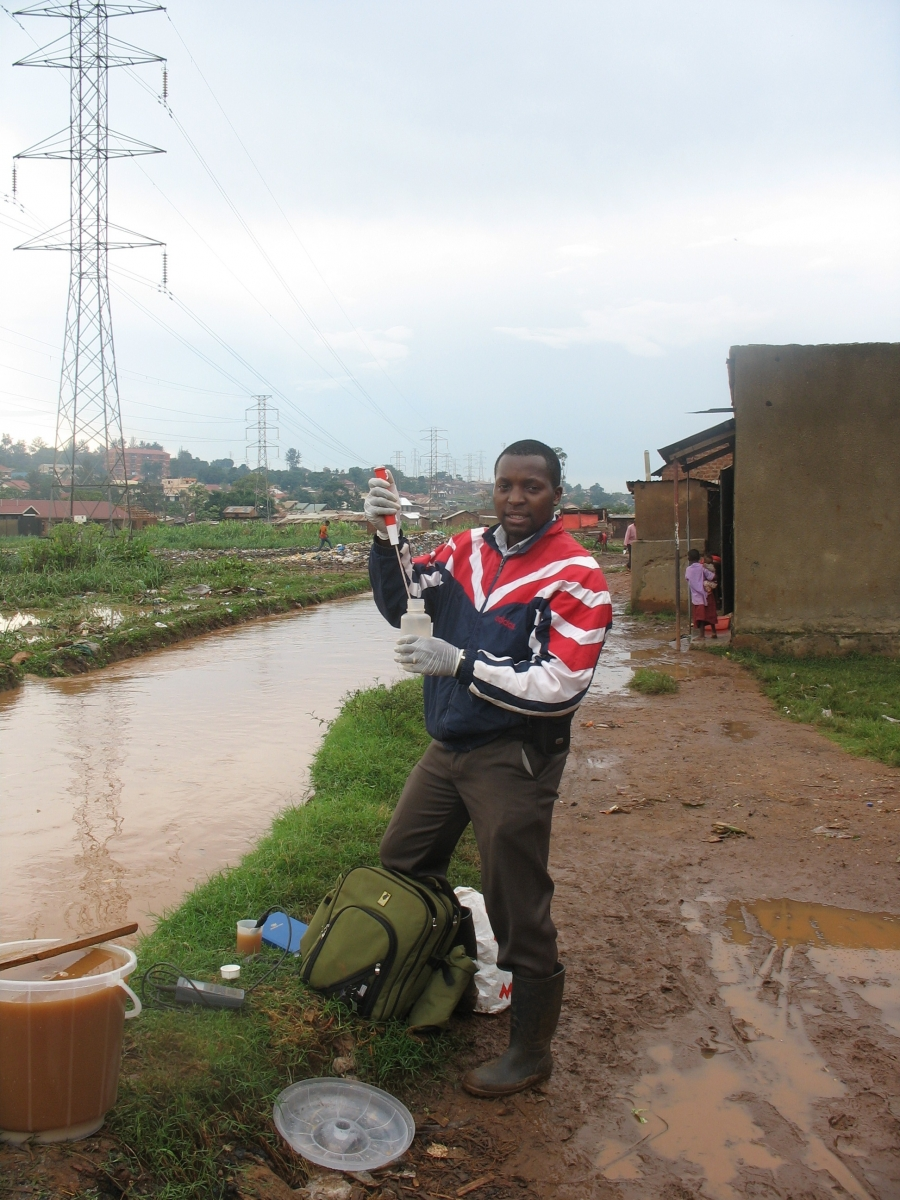 PhD student Philip Nyenje at work: measuring the discharge in Nsooba drain with the salt dilution method